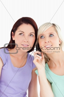 Portrait of smiling women on the phone