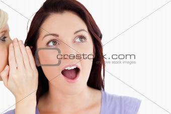 Close up of a surprised women being told a secret