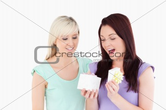 Blond woman gifting her friend