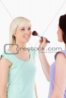 Charming Women applying make-up
