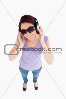 Gorgeous Woman with headphones and sunglasses