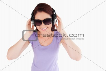 Beautiful Woman with headphones and sunglasses