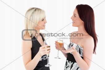 Cute well-dressed women drinking champaign