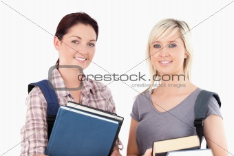 Close up of College students holding books