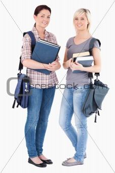 Portrait of College students holding books