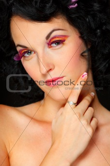 Portrait of dark hair pretty girl with hand near face