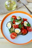 salad with eggplant, tomato and quail eggs