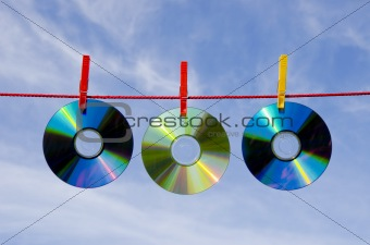 three dvd and cd disks and sky