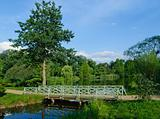 Romantic green wooden footbridge