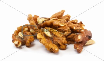 Crushed walnuts on white background
