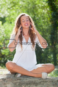 Beautiful Woman in Relaxation Listening Music