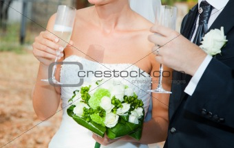 Bride and Groom Drinking a Toast