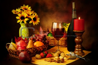 Wine, fruit and nuts still life