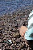 fisherman on pebbled shore
