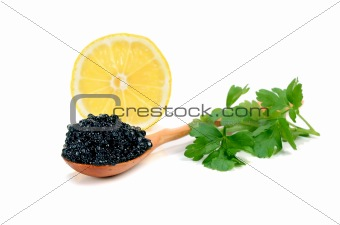 caviar black in a wooden spoon