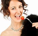 Female eating tomato