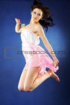Beautiful girl jumping lollipop