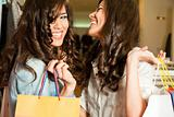 girls shopping laughing