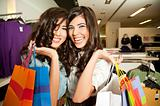 smiling girls shopping