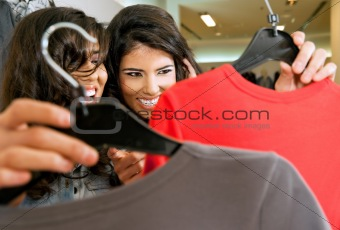 Girls lookig at clothes