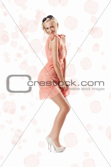 blond beautiful girl standing against white background