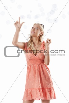blond beautiful girl playing against white background