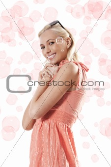 blond beautiful girl standing and smiling against white