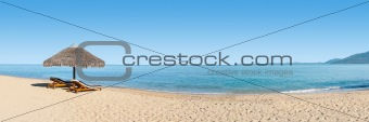 Deckchairs on the beach banner