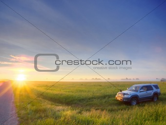 Car in field on sunset