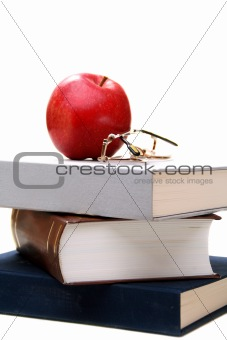 Stack of books and apple.