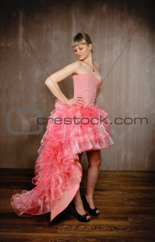 Beauty young blond girl in pink dress