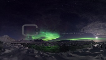 Northern Lights over the Arctic fjord - Spitsbergen, Svalbard
