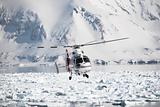 Helicopter rescue action over the Arctic fjord
