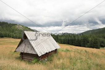 Old wooden hut in the mountains