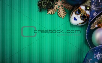 Green christmas card with carnaval mask