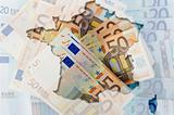 Outline map of France with transparent euro banknotes in backgro