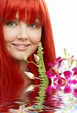 lovely redhead with orchid in water