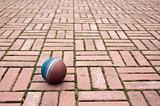 Ball on a pavement tiles