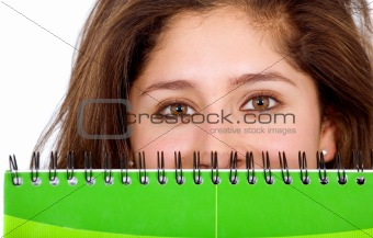 college student behind a notebook