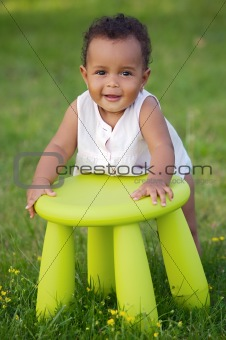 Toddler playing with chair