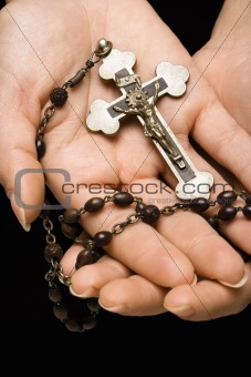 Hands holding rosary.