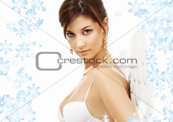 portrait of brunette angel girl with snowflakes