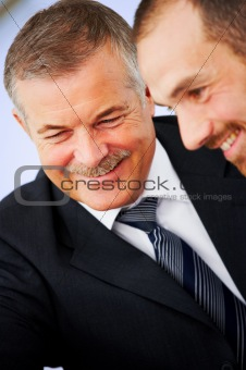 Business partners laughing