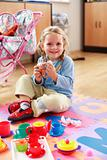 Cute girl playing with toys