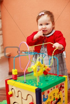 Portrait of cute baby with toys