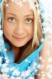 smiling blond in blue scarf with snowflakes