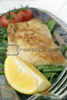 fish snack on ceramic platter; macro