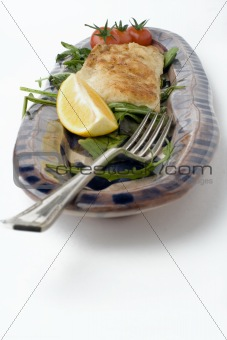 fish and salad on earthenware platter