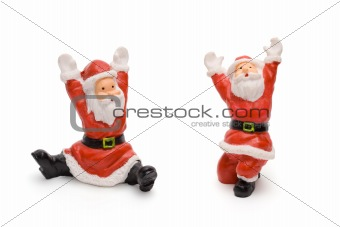 Santa Claus figurines isolated on white