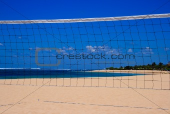 Blue sky through  volleyball net on the beach